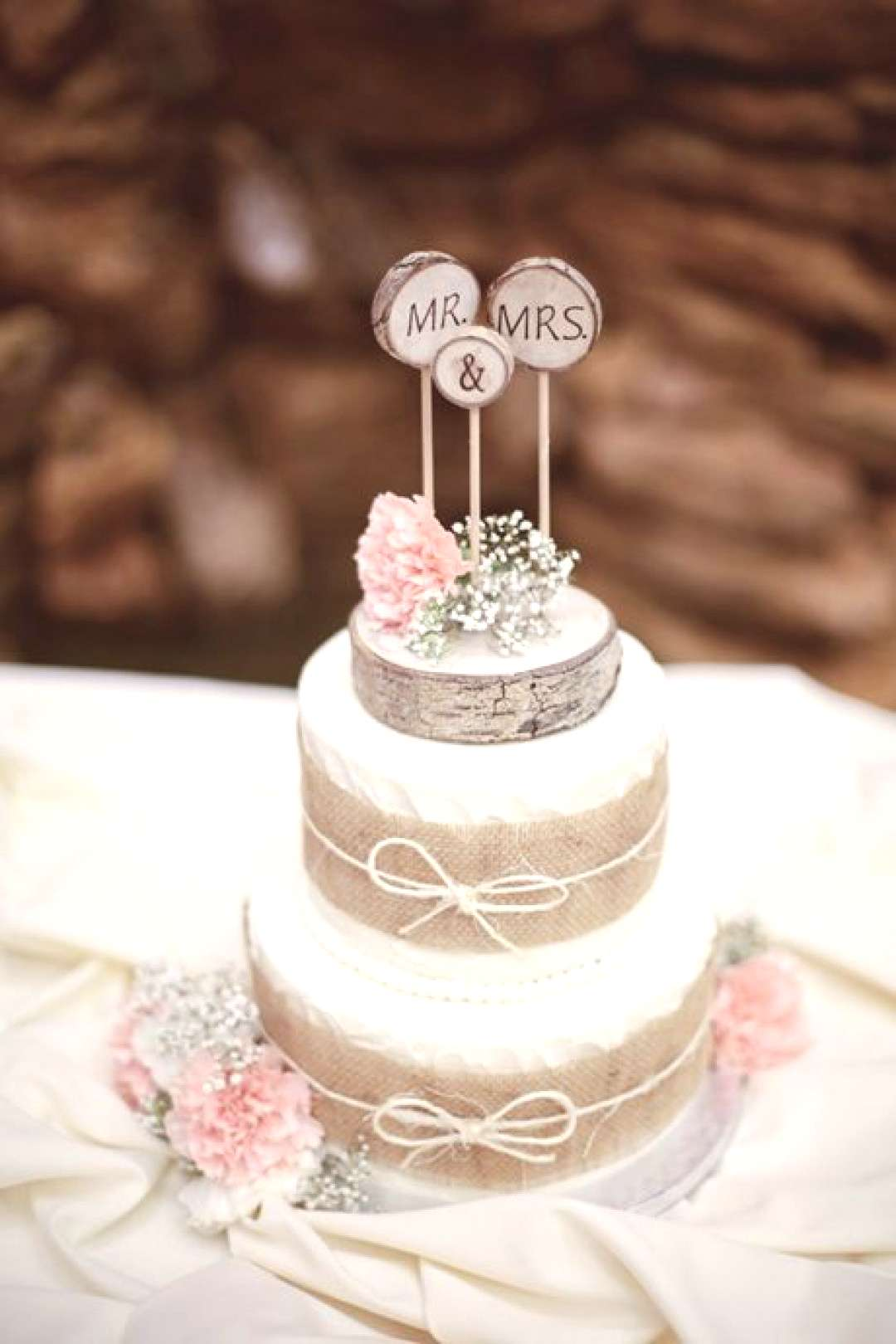 Wedding Cakes Photos amp Ideas - Brides Two-Tiered Cake with Burlap Ribbon. For a rustic bash, The